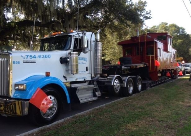 demonstrating heavy towing capabilities with towing a train car