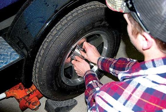 changing a flat tire at work